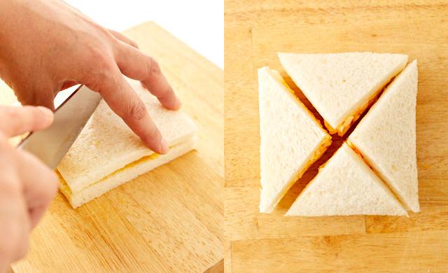 卵サンドを4等分に切っている写真