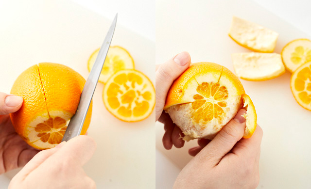 オレンジの皮をむいている写真