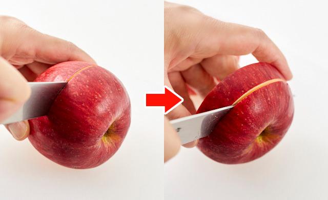 りんごを輪切りにする写真